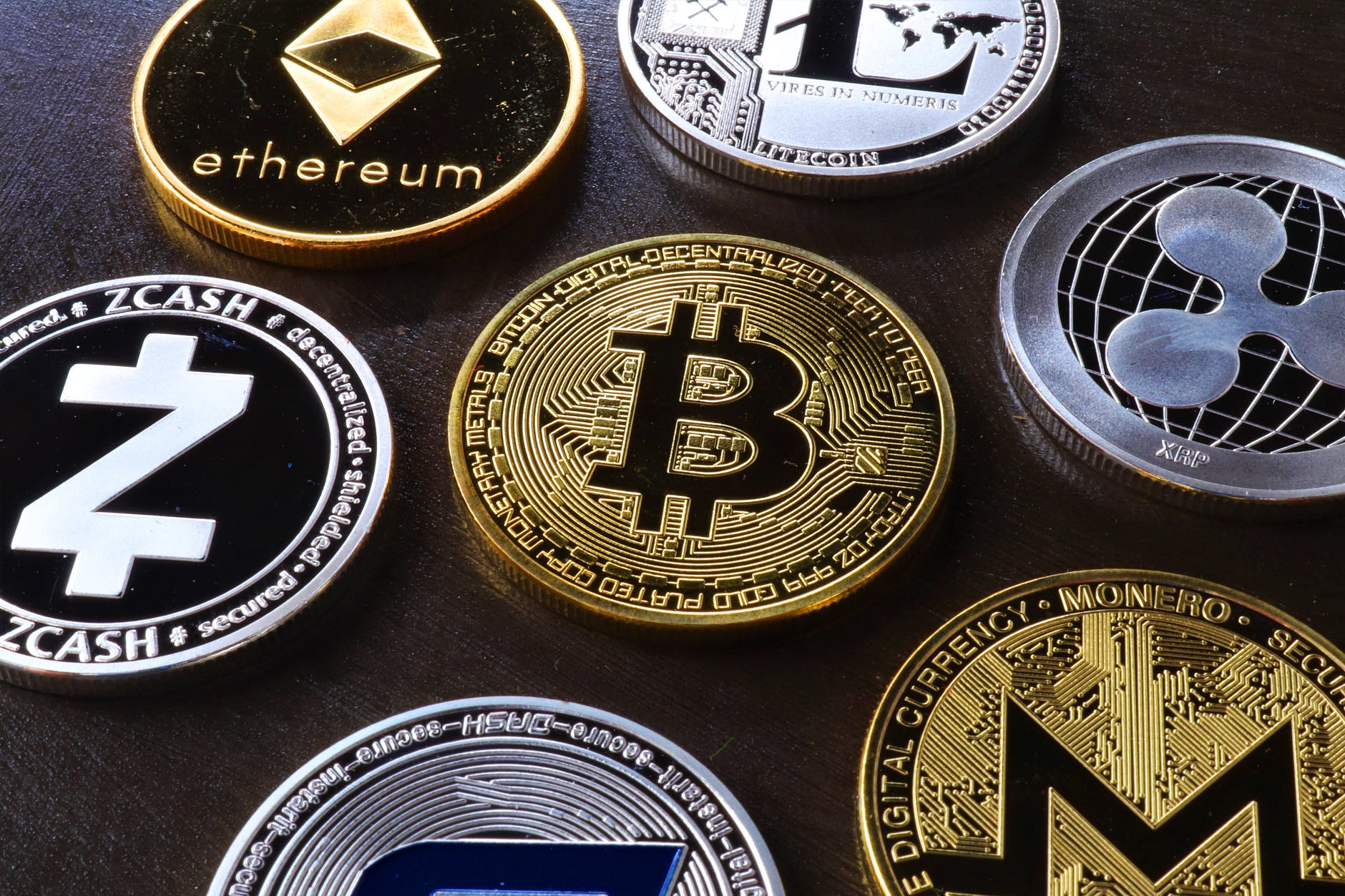 various cryptocurrency on table